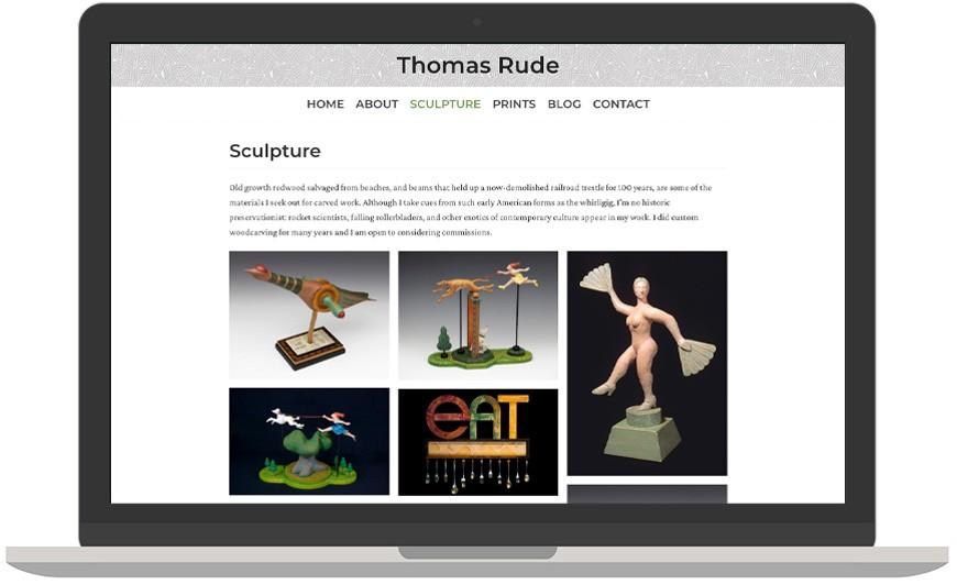 Thomas Rude's website as laptop mockup