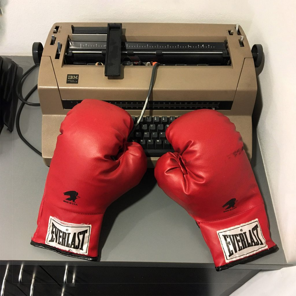 boxing gloves on a typewriter